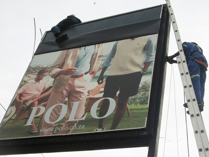 Building Signage and installation - Polo street sign being erected