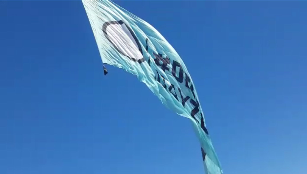 Aerial advertising - Flying helicopter banner in the sky - 9 - Defeat Day Zero